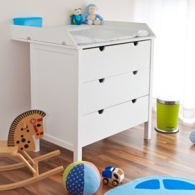 White changing table with drawers below.