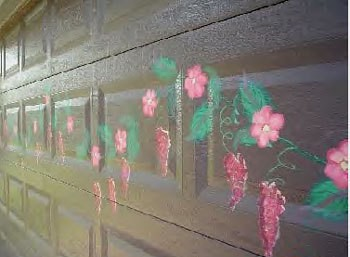Flowers painted on a garage door.