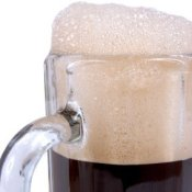 Root beer in a glass mug.