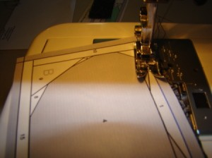 Sewing piece #2 onto piece #1 along printed stitching line.