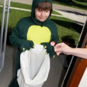 Boy Getting Candy in Dinosaur Costume