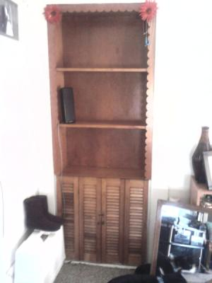 Built-in shelf unit with three shelves and lower doors.