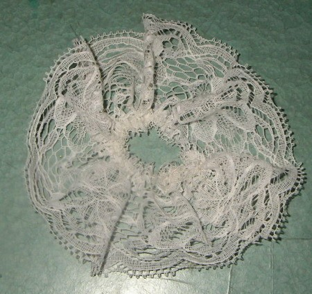 Lace after gathering with running stitch.