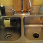 Bathtup basket attached to back of stainless steel kitchen sink