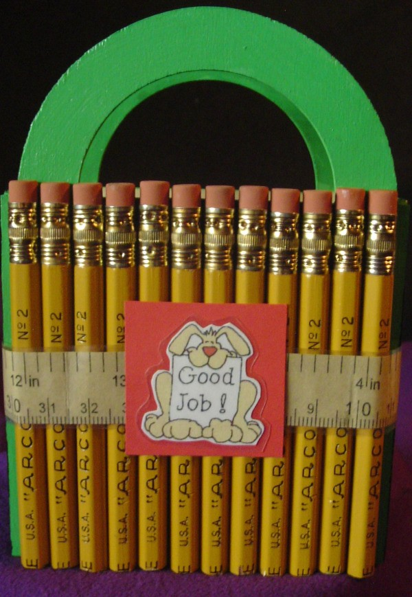 Pencils covering a wooden basket