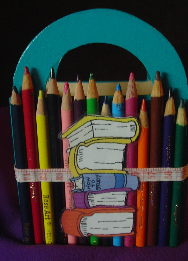 Colored pencils covering the outside of a wooden basket