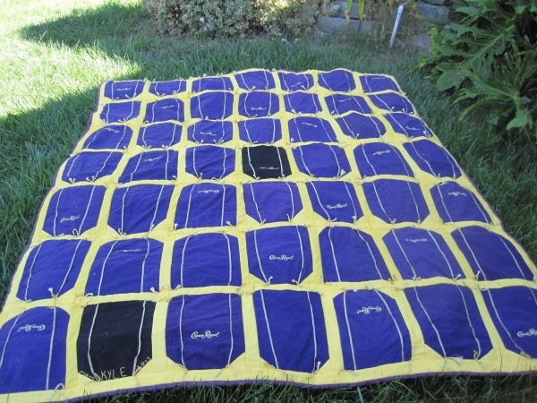 Crown Royal quilt lying on the lawn.