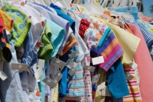 Photo of kids clothing in a closet.