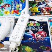 Photo of Wii games and Wii controller.