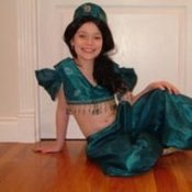 A young girl in a homemade Princess Jasmine costume.