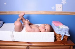 Photo of a baby on changing table.