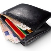 Black Wallet Stuffed With Cash and Credit Cards
