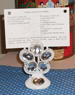 Decorative hair clip with clear faceted stones holding recipe.