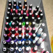 Bin with dozens of bottles of nail polish.