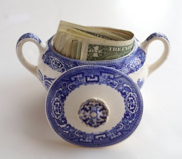 Money hidden in a china sugar pot.