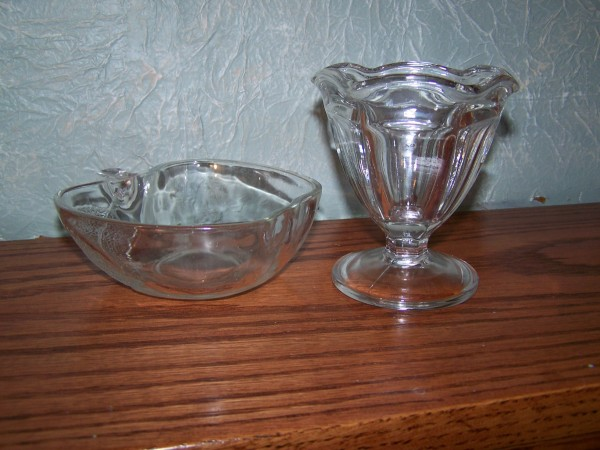 Apple shaped and stemmed glass dishes after cleaning.