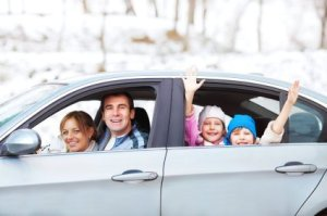Family in Car Leaving in Winter