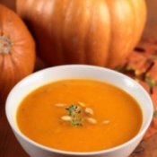 Pumpkin Soup with Pumpkins in the Background