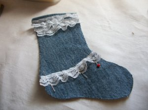 Half of stocking with lace at top and across the instep.