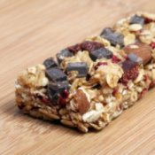 An energy bar with chocolate, dried fruit, and nuts.