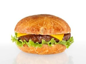 Photo of a hamburger with a homemade bun.