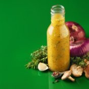 A bottle of homemade salad dressing.
