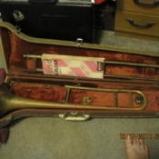 Old trombone in case.