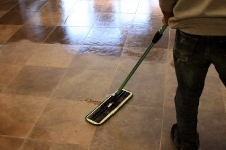 Saving Money on Swiffer Pads and Mops, Linoleum Floor Being Mopped