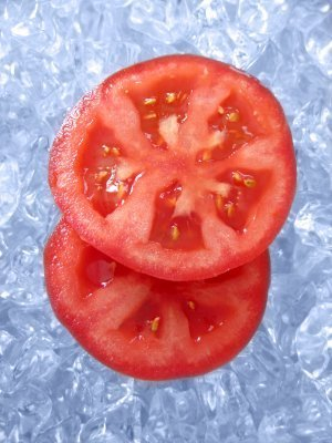 Tw Red Tomatoes sitting in Ice