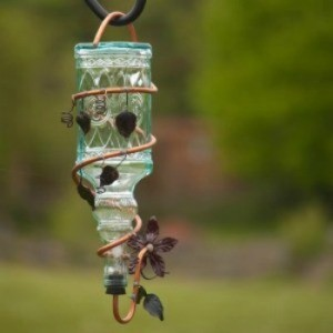 A glass hummingbird feeder.