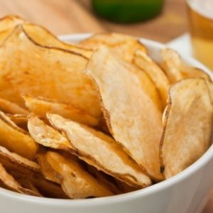 Homemade potato chips in a bowl.