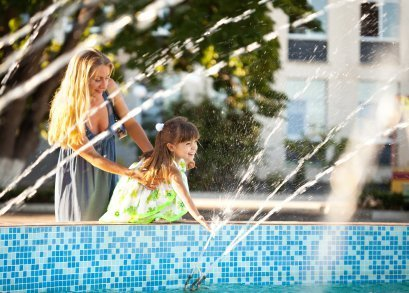 Free Entertainment Ideas, Mother and Daughter Playing in a Fountain