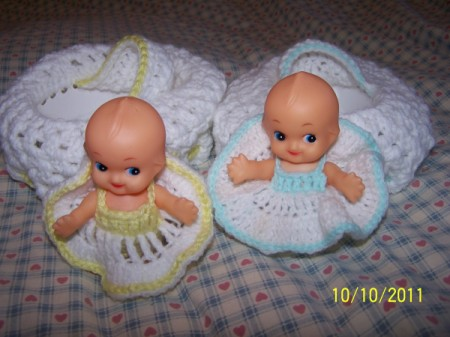 Kewpies in crocheted dresses.