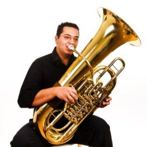 A man playing a tuba.