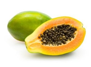 Whole papaya and cut half with black seeds