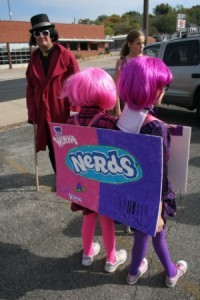 Girls Turned Away to See Back of Nerds Costume