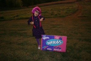 Girl Standing in Grass With Nerds Box Costume