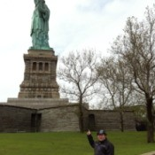 Fletcher Pointing at the Statue of Liberty