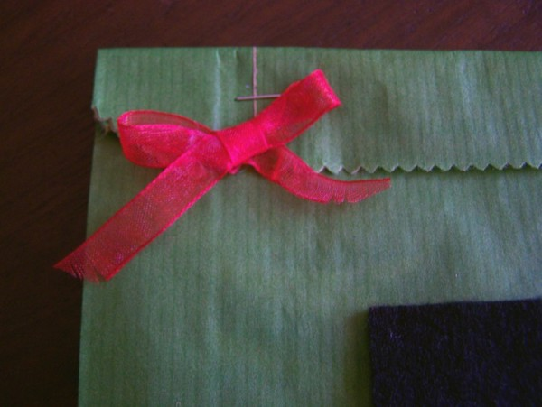 Red Bow on green gift bag