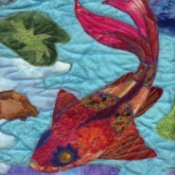Up close photo of a colorful koi quilt.