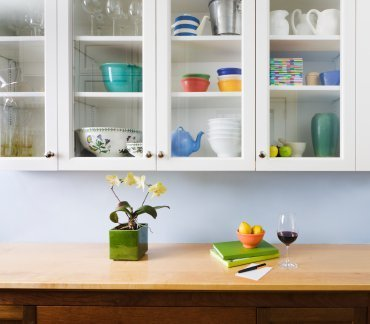 Photo of organized kitchen cabinets.