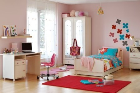Photo of an organized girls bedroom.