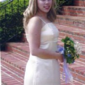 Photo of a girl wearing a homemade bridesmaid dress.