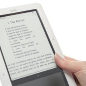 A person holding a Nook reader.