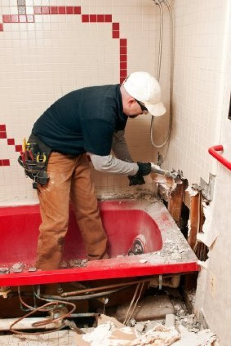 Saving Money on a Bathroom Remodel, Man Working on Remodeling a Bathroom