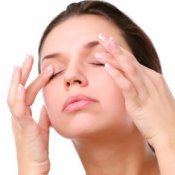 Woman massaging her eyes