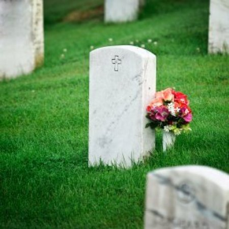 Saving Money on Funeral Expenses, A headstone at a cemetery.
