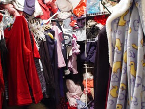 Photo of a messy closet.