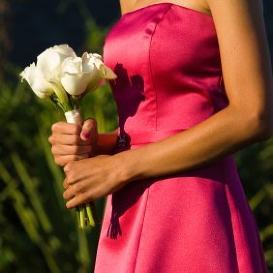 A woman wearing a homemade bridesmaid dress.