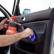 Man Cleaning Car Interior